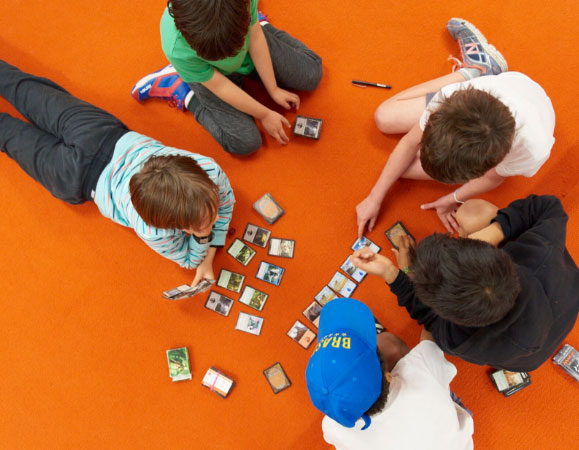 School Kids playing cards game